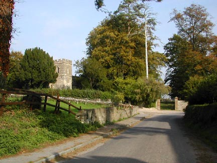 Fifehead church on left.  Entrance gate to the manor in front